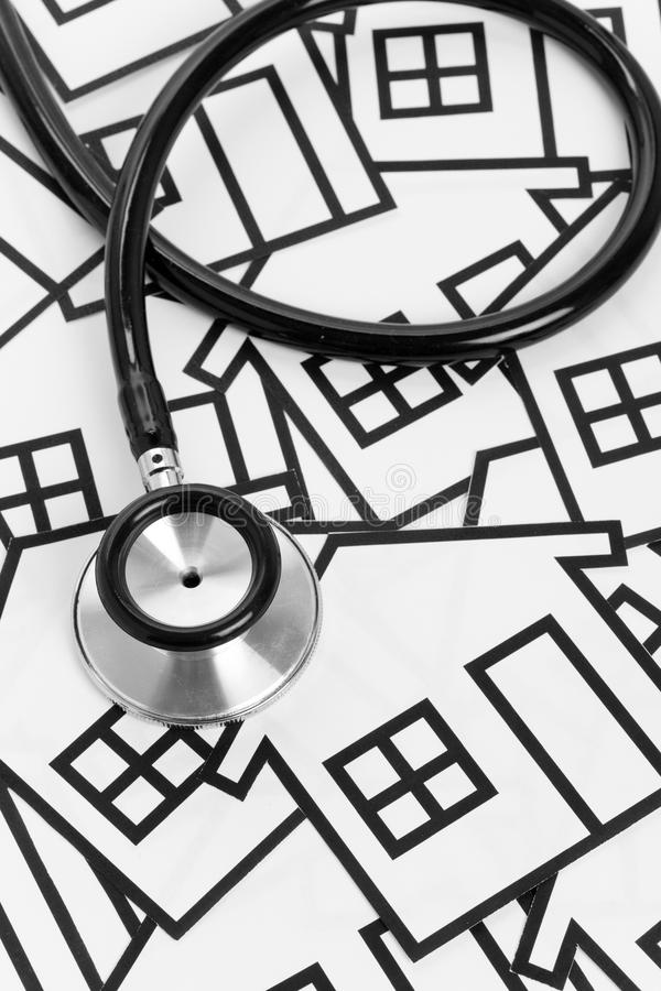 Stethoscope and House. Concept of Real Estate Problems stock images