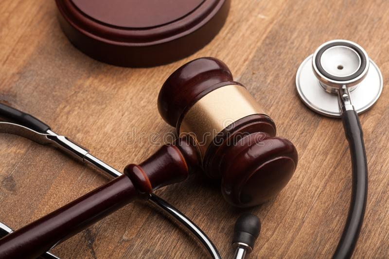 Stethoscope and judgement hammer. Injury personal law stethoscope gavel lawyer royalty free stock photos