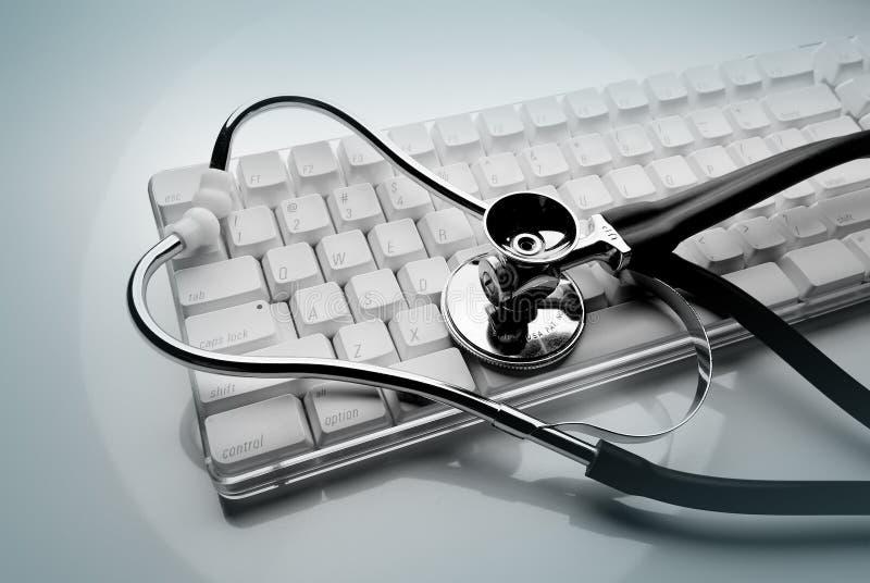 Stethoscope on keyboard. Medical stethoscope on white keyboard shot on pale green background stock photos