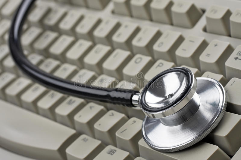Stethoscope and keyboard stock photography