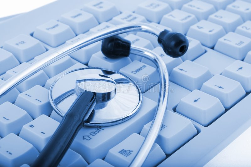 A stethoscope with keyboard. A stethoscope on a computer keyboard (on blue tone stock photography