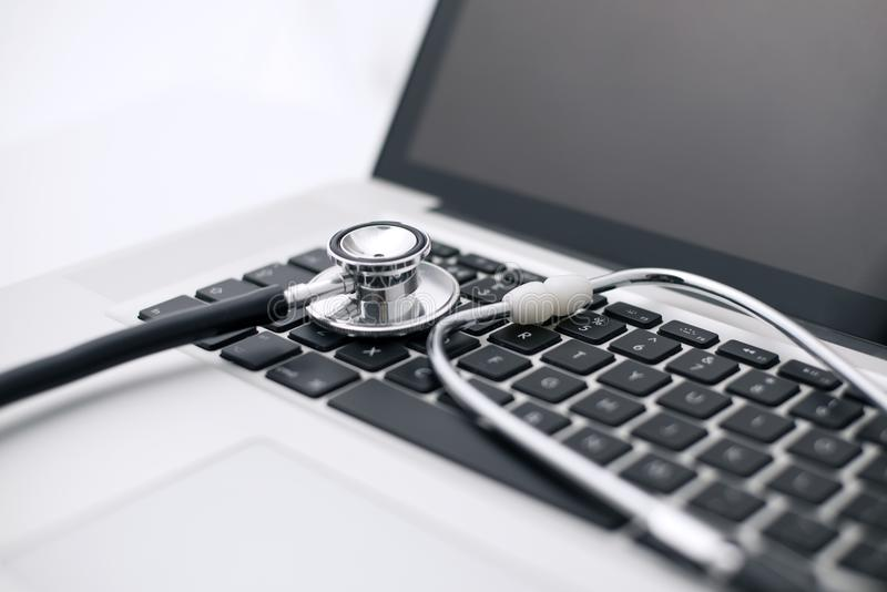 Stethoscope Laid on a Laptop Computer`s Keyboard stock photos