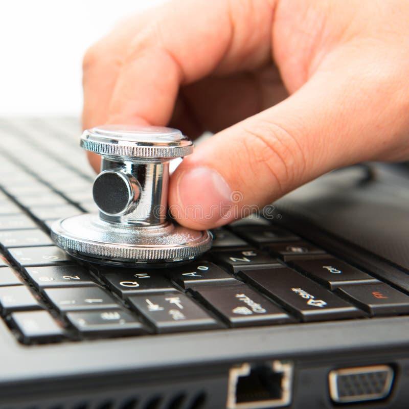 Stethoscope and laptop stock photos