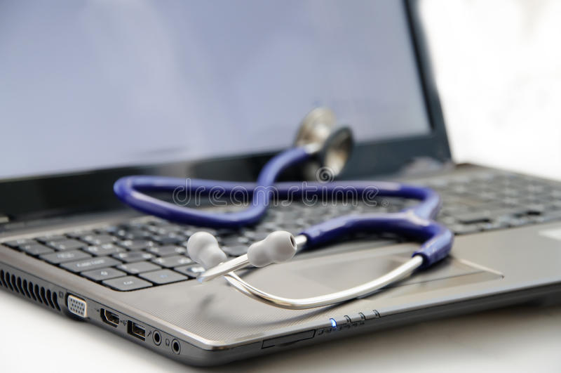 Stethoscope on laptop royalty free stock photos