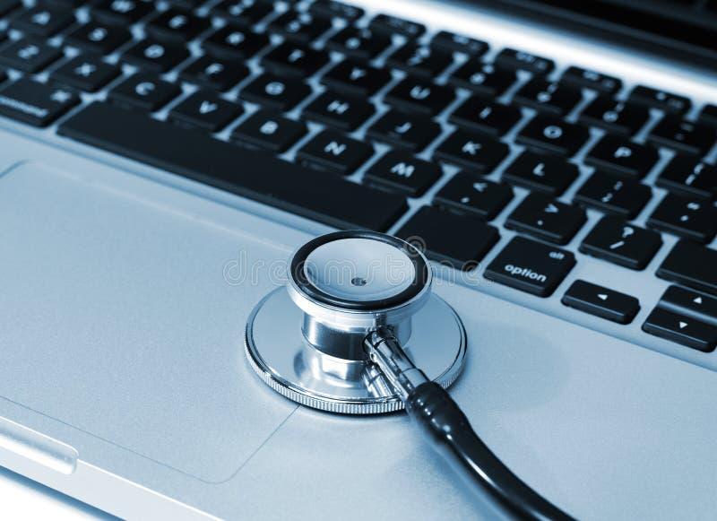 Stethoscope on laptop stock photos
