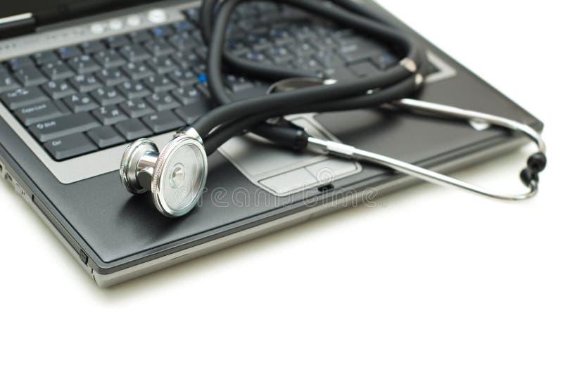 Stethoscope And Laptop Illustrating Stock Photo