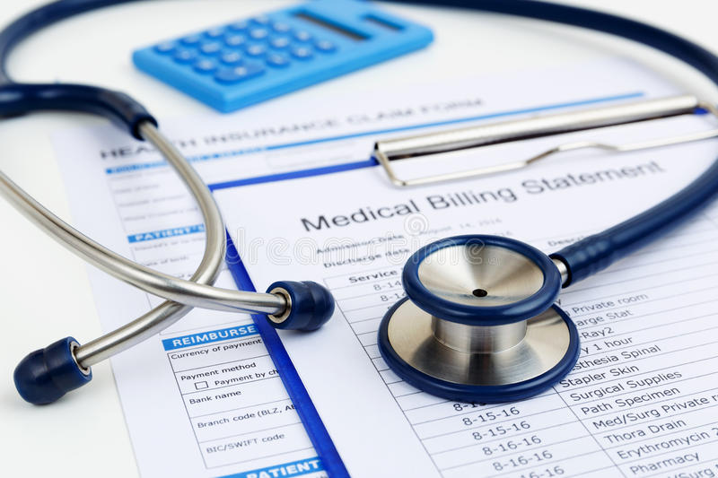 Stethoscope on medical bills and insurance. Stethoscope on medical bills and health insurance claim form stock image