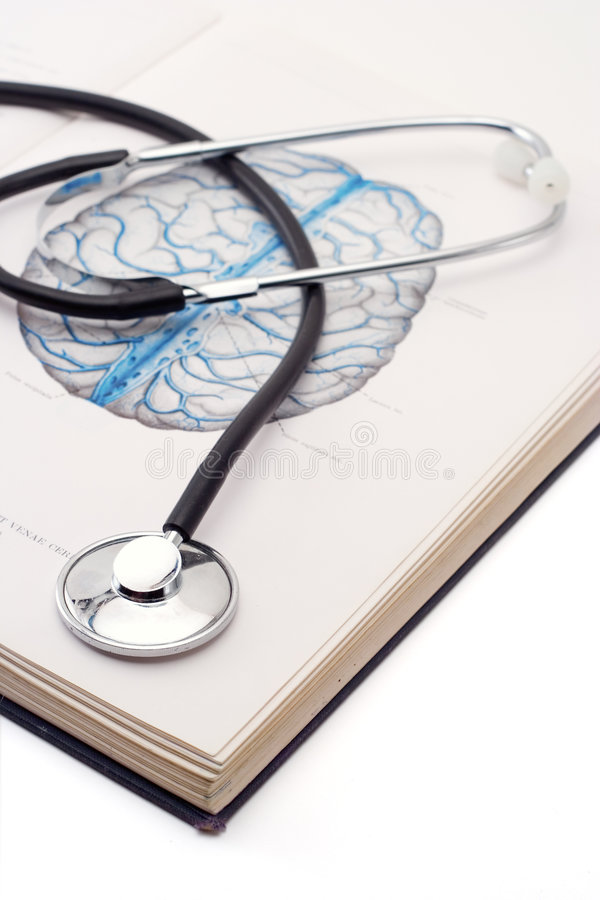 Stethoscope on a medical book royalty free stock photos