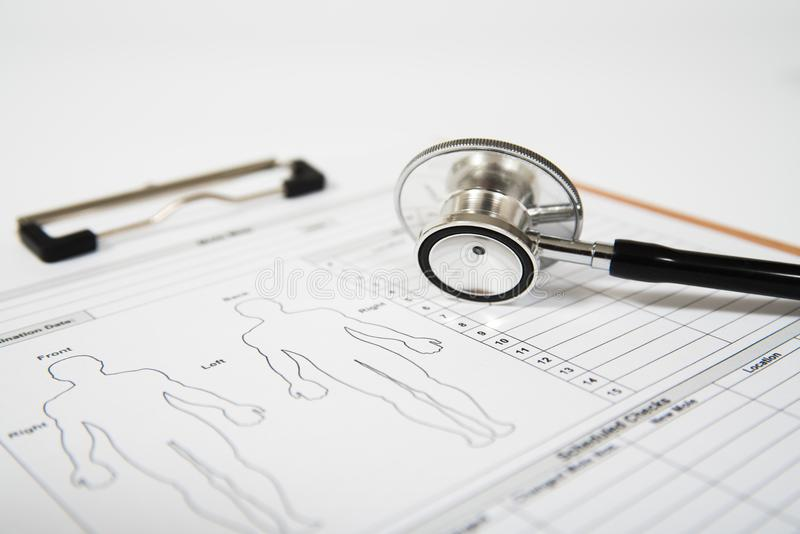 Stethoscope on a medical form. Healthcare concept stock images