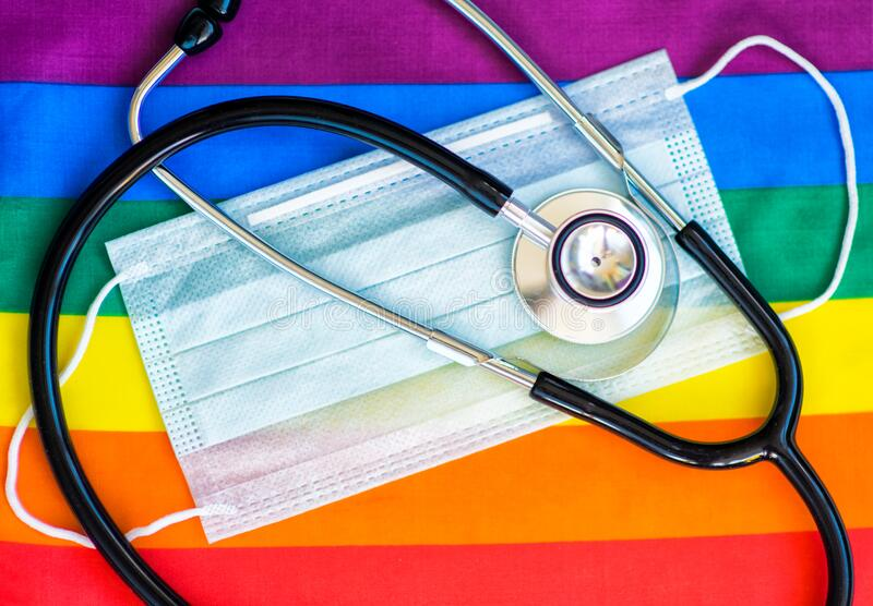 Stethoscope and medical mask on the rainbow flag, LGBT. Symbol royalty free stock photos