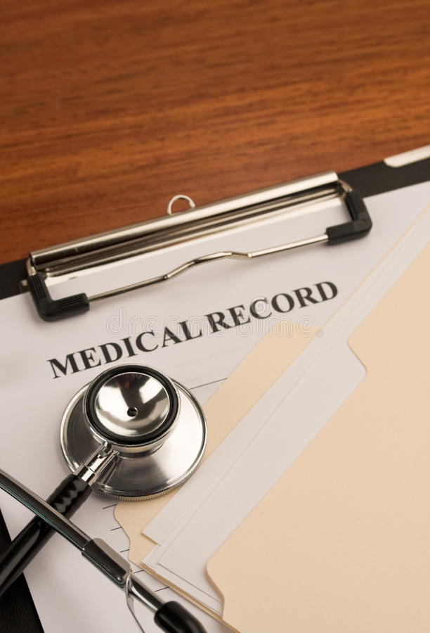Stethoscope and medical record 2 stock photo