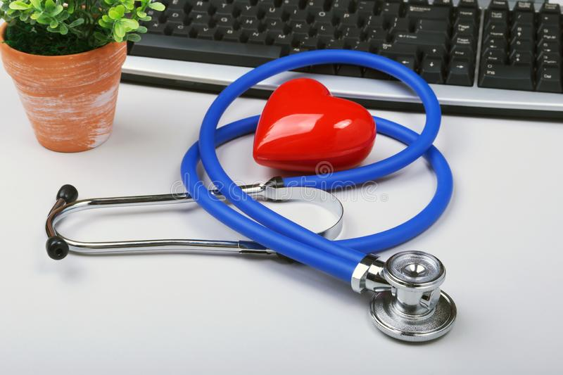 Stethoscope on modern laptop computer. red heart on white table with space for text. Healthcare concept.  stock photo