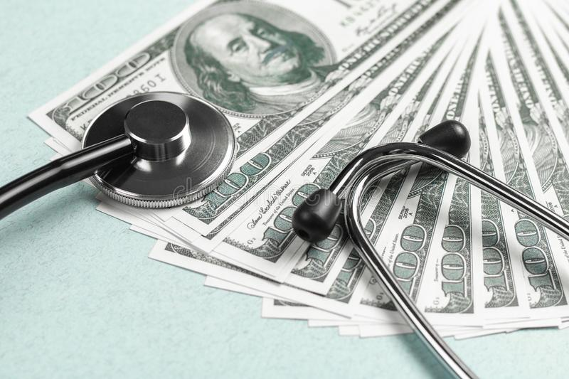 Stethoscope and money, concept. Paid medicine. Costs for the medical insurance stock photos