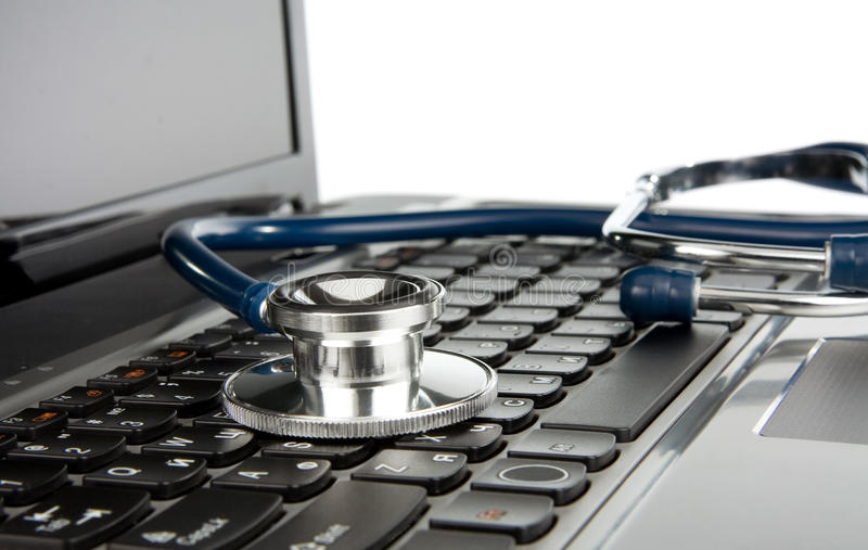 Stethoscope at notebook laptop isolated on white royalty free stock photos