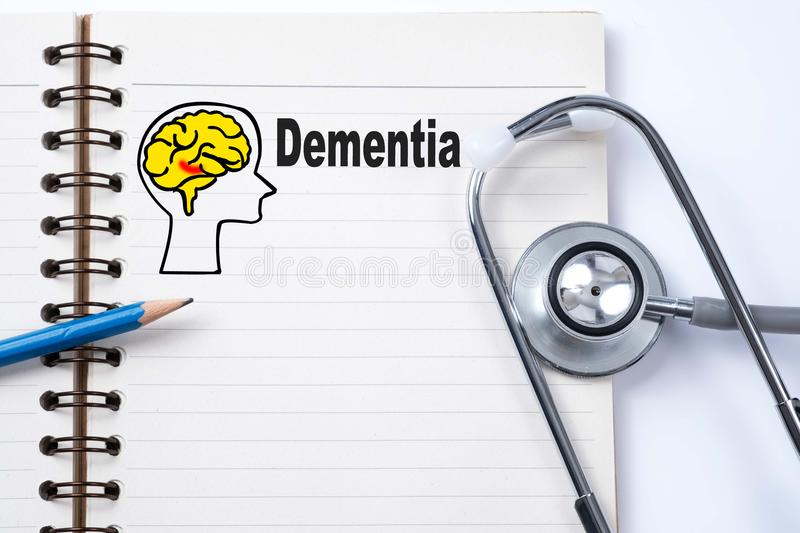 Stethoscope on notebook and pencil with Dementia words as medical concept. royalty free stock photography