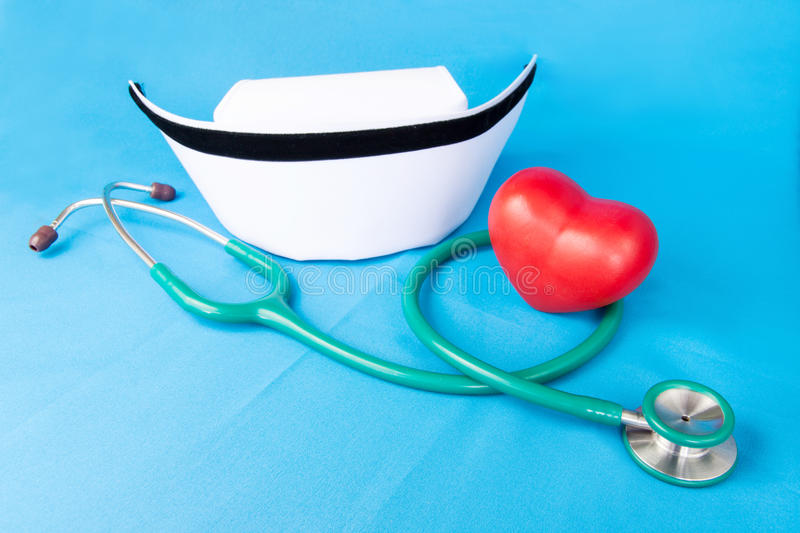 Stethoscope and nurse hat royalty free stock images
