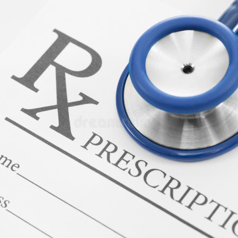Stethoscope over blank medical prescription form - studio shot - 1 to 1 ratio stock image