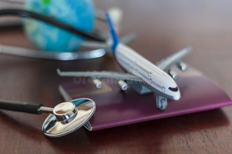 Stethoscope , passport document, airplane and globe. Global Healthcare and travel insurance concept.  stock images