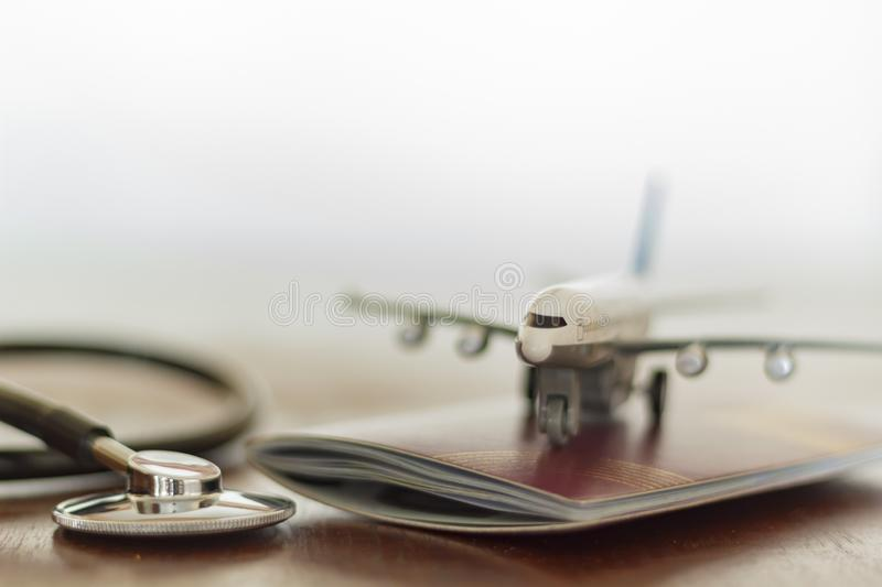 Stethoscope , passport document and airplane: Medical Travel concept royalty free stock photography