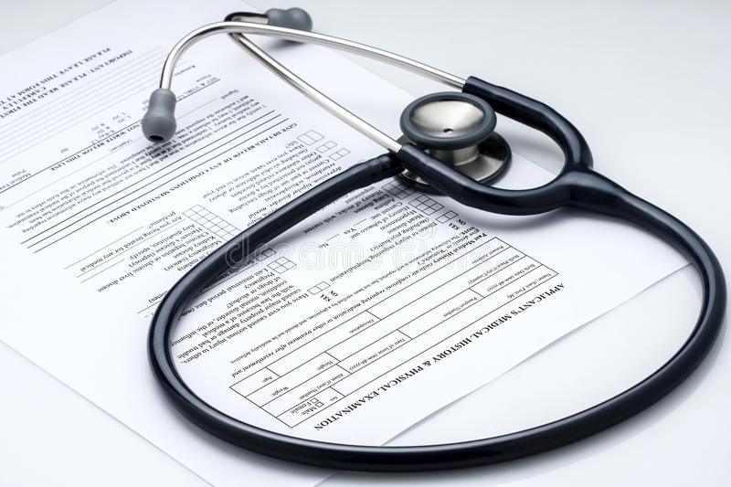 Stethoscope Physical Examination Patient Info. Stethoscope Phonendoscope lying on blank patient s medical history and physical examination form royalty free stock images