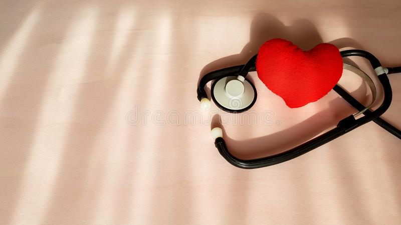 Stethoscope and red heart on natural light sources background, top view. Healthcare and medical concept.  stock images