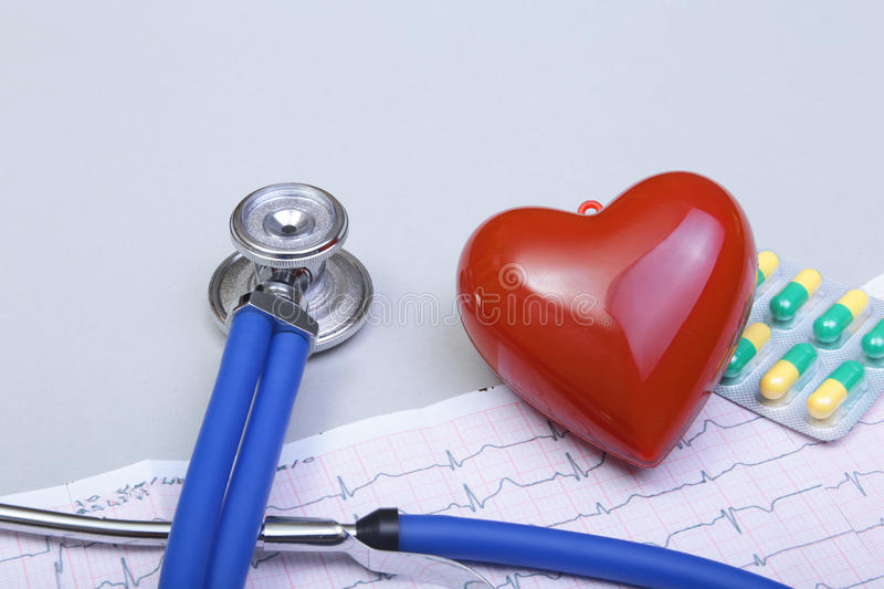 Stethoscope and red heart, on white background.  stock images