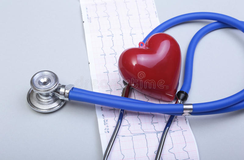 Stethoscope and red heart, on white background.  stock image