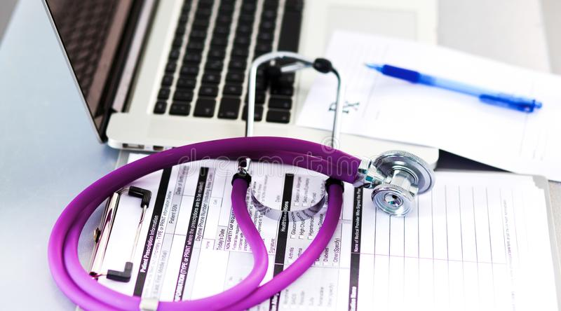 Stethoscope resting on a computer keyboard - concept for online medicine or IT support.  stock images