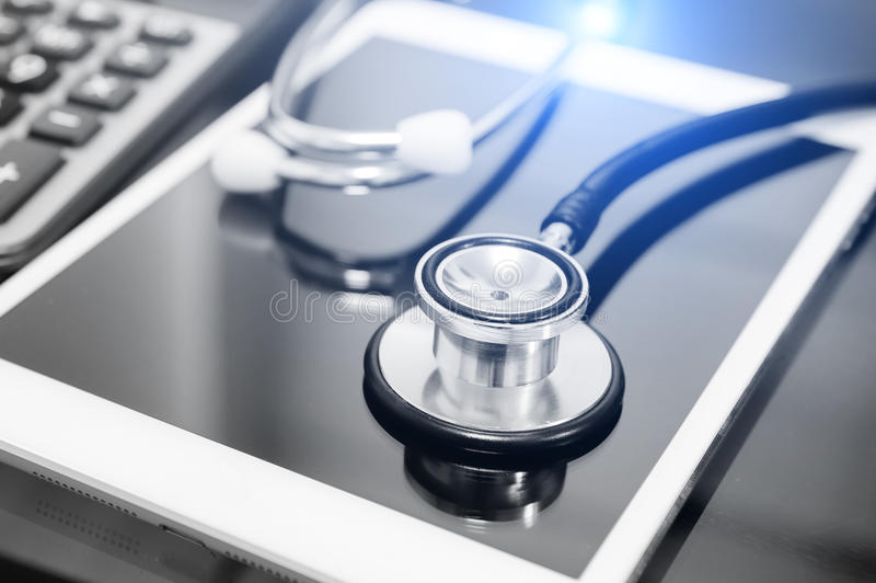 Stethoscope on smartphone. Stethoscope on smartphone, Checking security on smartphone concept stock photos