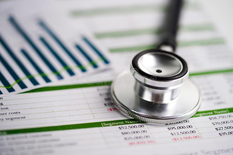 Stethoscope on spreadsheet paper, Finance, Account, Statistics, Investment, Analytic research data economy spreadsheet. And Business company concept stock photography