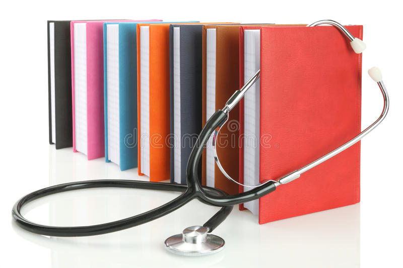 Stethoscope with a stack of books stock photos