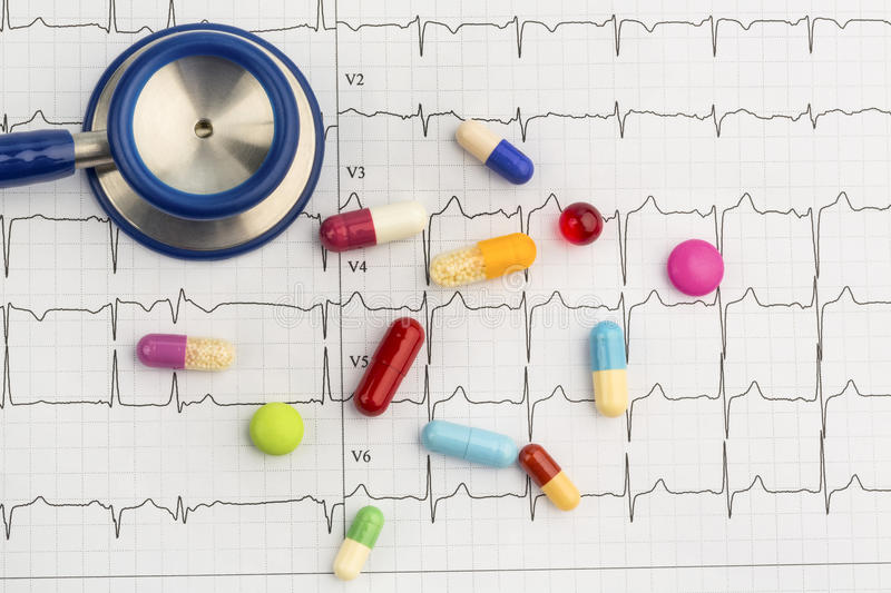 Stethoscope and tablets on an ecg stock photography
