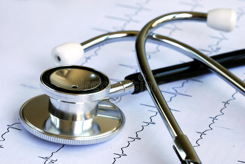 A stethoscope on the top of the EKG chart royalty free stock photos