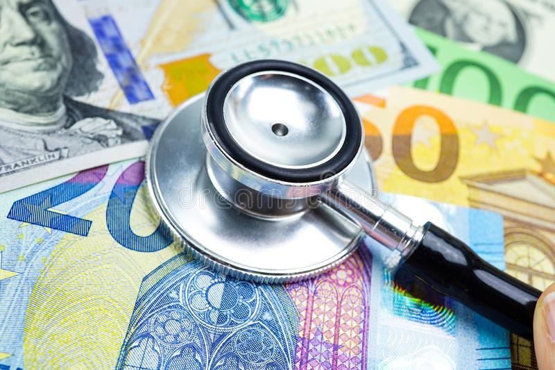 Stethoscope on US dollar and EU banknotes, Finance, Account, Statistics, Analytic research data and Business company meeting. Stethoscope on US dollar and EU stock image