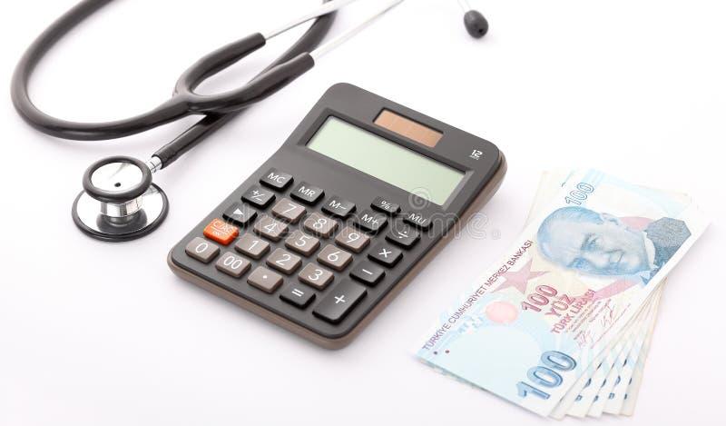 Stethoskop, Taschenrechner und türkische Lira lizenzfreie stockfotos