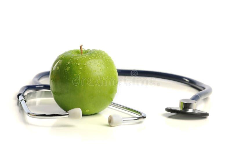 Stethoskop und Apple stockfoto