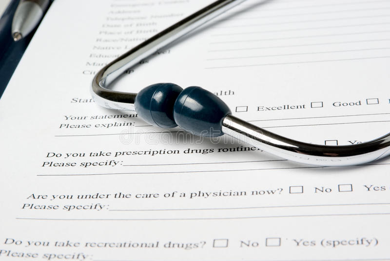 Stetjhoscope on medical questionnaire royalty free stock photos