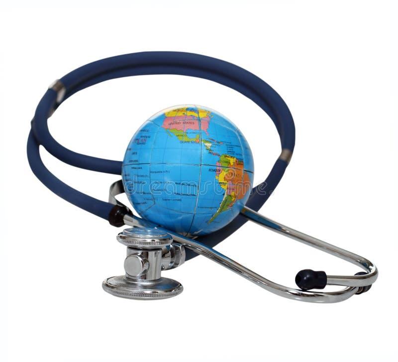 Stetoscopio con il globo fotografie stock libere da diritti