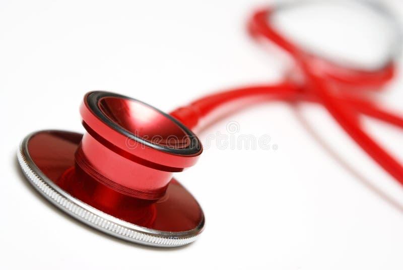 Stetoscopio di rosso del primo piano fotografia stock