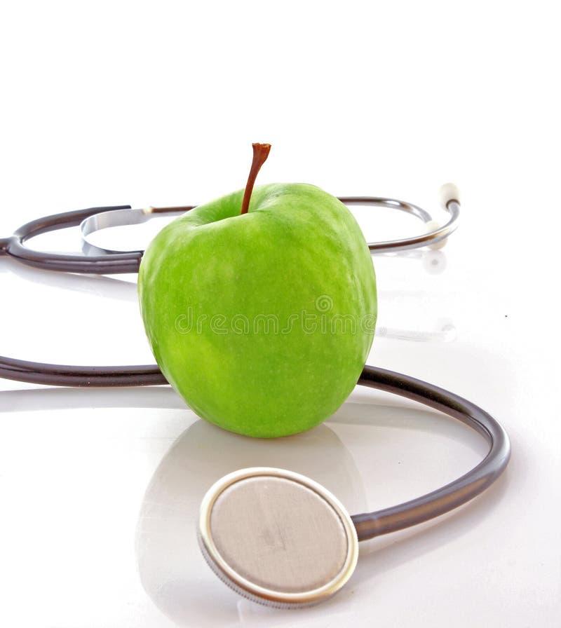Stetoscopio e mela fotografia stock libera da diritti
