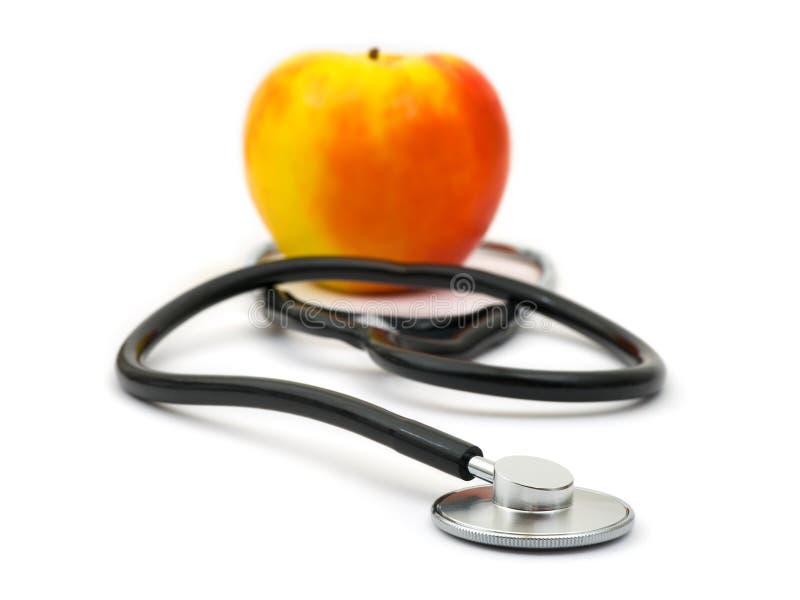 Stetoscopio e mela medici immagini stock libere da diritti