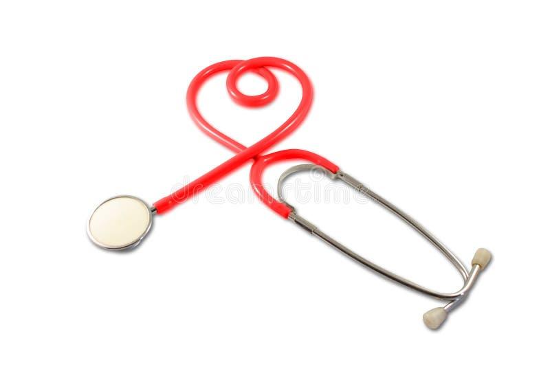 Stetoscopio nella figura del cuore immagini stock