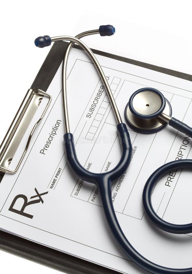 Stetoskop i recepta na białym tle odizolowywającym zdjęcia stock