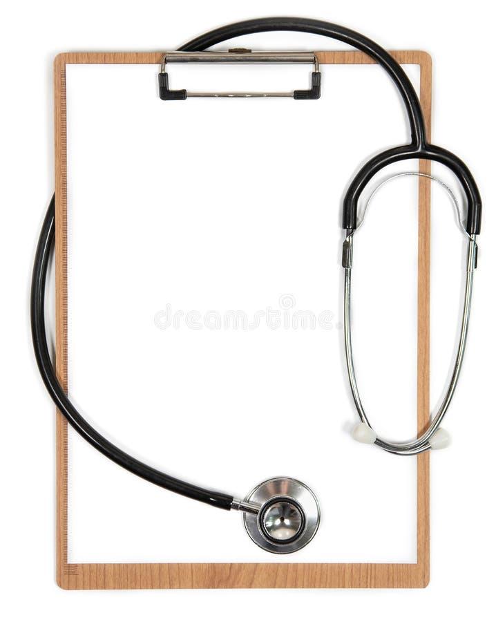 Stetoskop i schowek z pustym białym prześcieradłem przestrzeń papieru i kopii zdjęcia royalty free