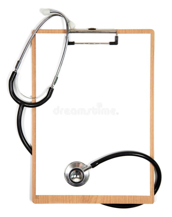 Stetoskop i schowek z pustym białym prześcieradłem przestrzeń papieru i kopii obrazy royalty free