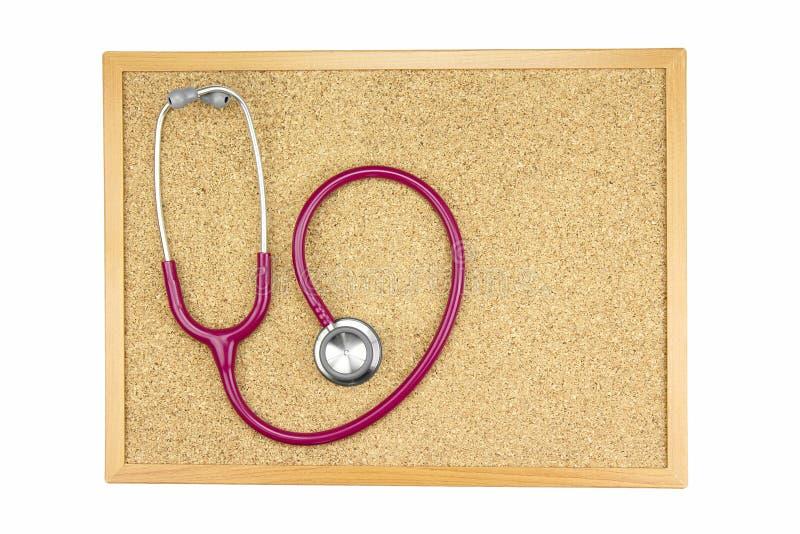 Stetoskop på ett bräde, en läkarundersökning och undersöka för kork royaltyfri bild
