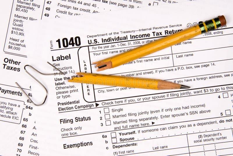 Steuerformulare und Frustration stockbild