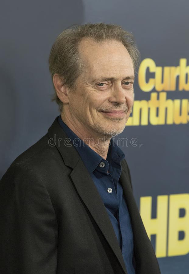 Steve Buscemi. Film and television `Boardwalk Empire` character actor Steve Buscemi arrives for the NY premiere of the 9th season of HBO`s hit comedy, `Curb Your royalty free stock photo