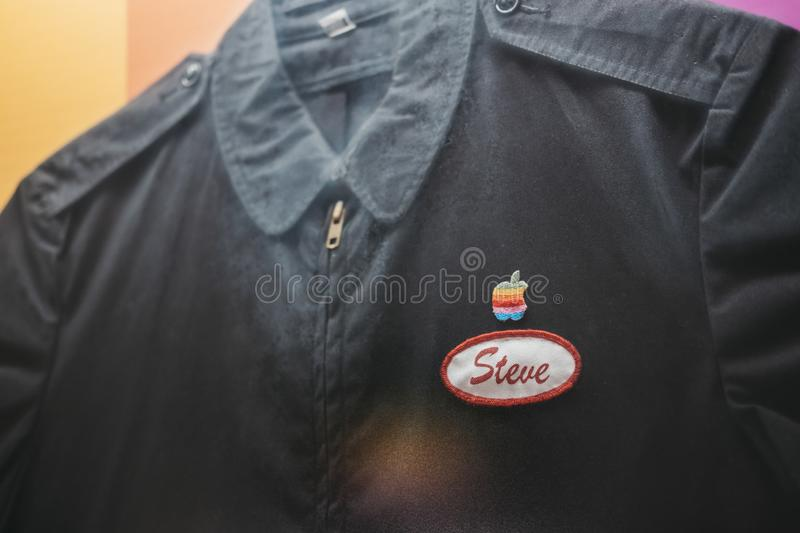 Steve Jobs ` old Apple uniform overalls on exhibit inside Apple Museum in Prague, Czech Republic. Prague, Czech Republic - August 28, 2018: Steve Jobs ` old stock image