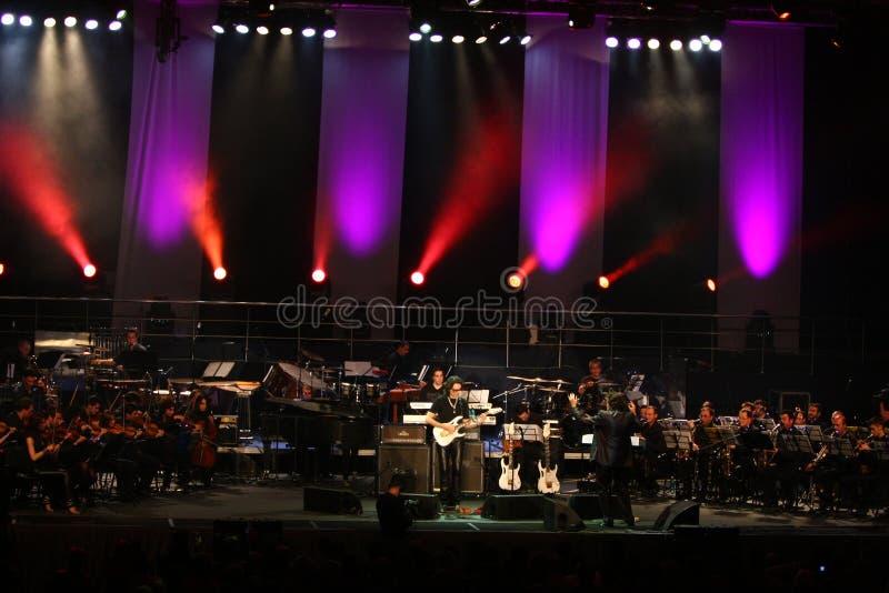 Steve Vai et l'orchestre de tempo d'évolution image libre de droits